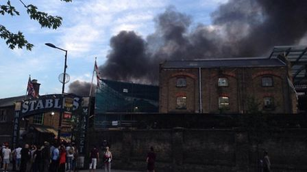 Large plumes of smoke billow from the world famous Stables Market in Camden Town. Picture: Twitter @