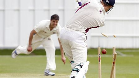 Hampstead's Zak Khan (left) bowls North Middlesex's Nick Brand at Park Road in Crouch End. Pic: Max