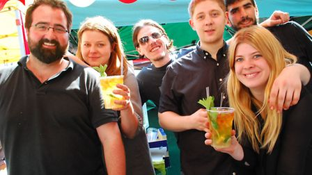 The team from the Princess of Wales pub keep the Pimms flowing. Picture: Polly Hancock