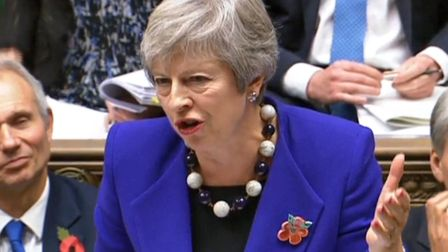 Prime Minister Theresa May speaks during Prime Minister's Questions in the House of Commons. Photogr