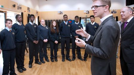Jules Pipe, Mayor of Hackney (right), and Anthony Impey, chief executive of Optimity, with students