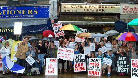 Traders and residents gather in South End Road to demonstrate their objection to the proposed new Sa