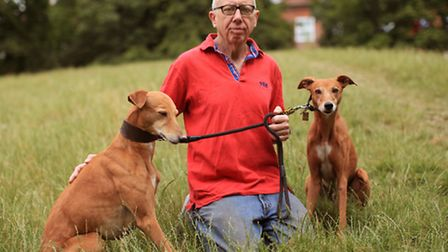 Dog owner Brian Cleghorne with his two Whippets at Clissold Park.