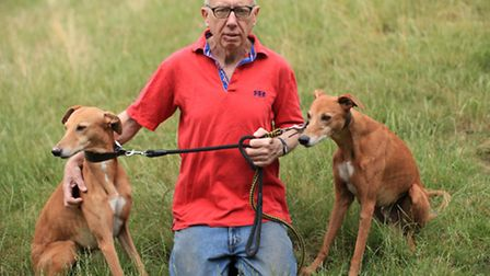 Dog owner Brian Cleghorne with his two Whippets in Clissold Park.