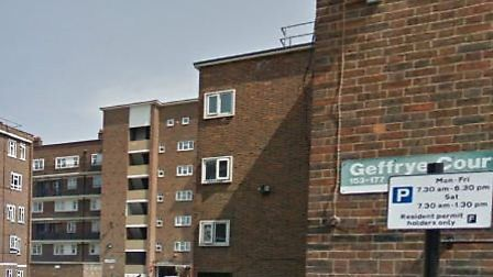 The suspected murder took place at Geffrye Court in Hackney, where a woman (not pictured) was arrest