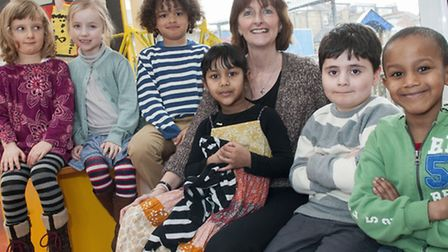 Kate Frood pictured with young pupils. Picture: Nigel Sutton