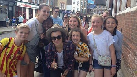 Harry, 20, was flanked by fans during his wander around Stoke Newington