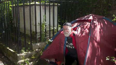 One of the Hampstead police station squatters - Michael Dickinson - has been camping in a graveyard