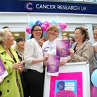 Cancer Research UK shop on Hampstead High Street celebrates it's first six months. Pictured centre,
