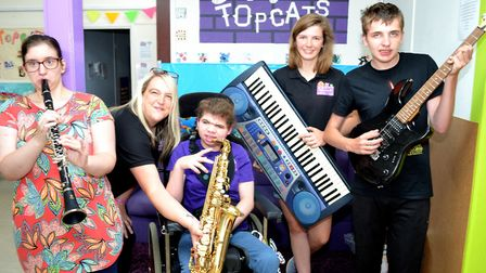 Some of the members and staff at the 'Topcats' centre for young people with disabilities and additio