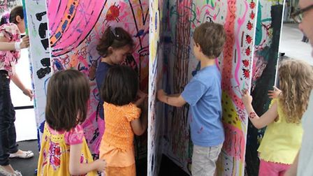 Children's author and illustrator James Mayhew's giant pop-up book at one of the Pop Up Festival of