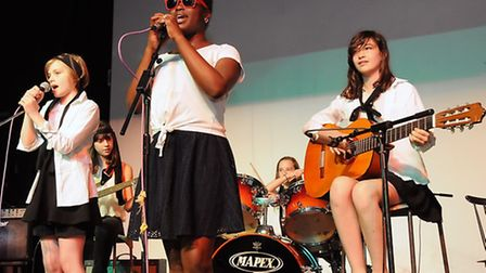 Yr 7 band Tourist Under Cover perform for judges Viv Albertine of The Slits, Mark Bedford of Madness