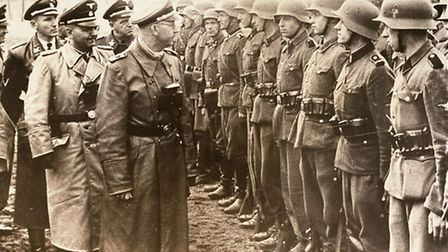 Head of the SS Heinrich Himmler, centre, reviewing troops of the Galician SS-Volunteer Infantry Divi