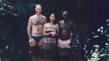 Juliette D'Souza and Keith Bender (left) in Suriname, with a man who Mr Bender was told was the powe