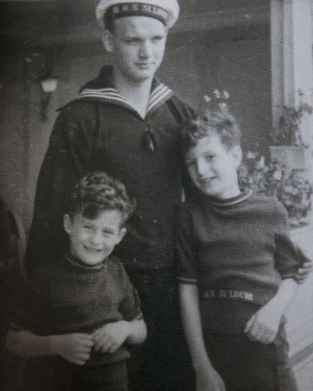 Rolf (left) and Gerd (right) Altschul with a young German sailor named Hein who they befriended on t