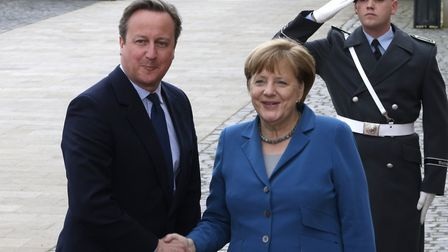 Britain's Prime Minister David Cameron is welcomed by German Chancellor Angela Merkel at Herrenhause