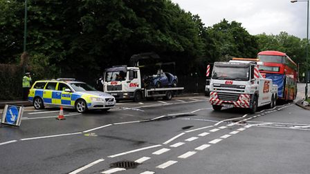 Police seal off the scene after a bus crashed with a car. Photo: David Mirzoeff