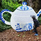 Leonardo Franco, 5, looks at a giant teapot at The Museum of Childhood