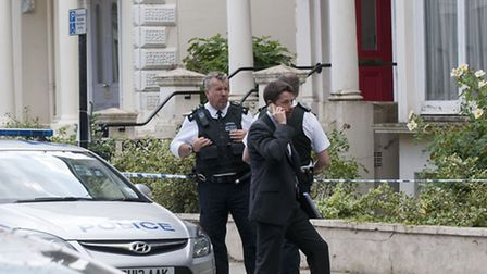 Officers at the scene of the murder investigation in Belsize Park. Picture: Nigel Sutton