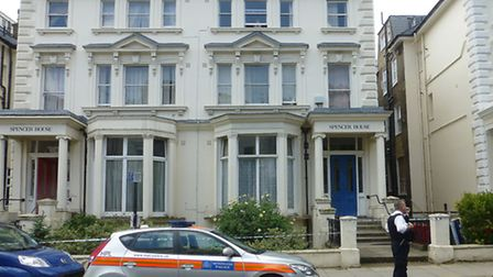 The man was found suffering from suspected stab wounds at Spencer House sheltered accommodation. Pic