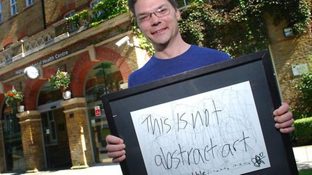 A patient showing one of the pieces of his work exhibited at Highgate Mental Health Centre. Picture: