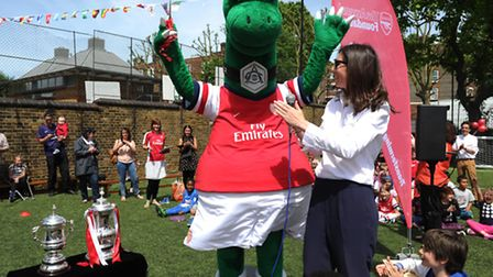 Gunnersaurus, the Arsenal FC mascot, opens the all-weather pitch at Torriano Infant and Junior Schoo