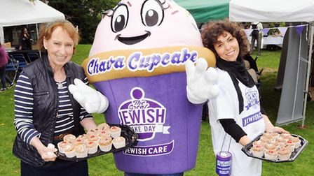 Giant cupcake volunteers Sidy Ciffer (left) and Karen Simon. Picture: Dieter Perry.