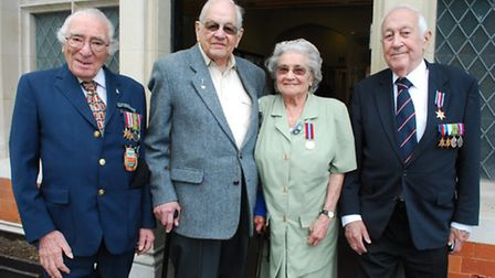 D-Day veterans Walter Schneiderman, 91, Colin Anson, 92, Alice Anson, 89, and Bill Howard, 94, outsi