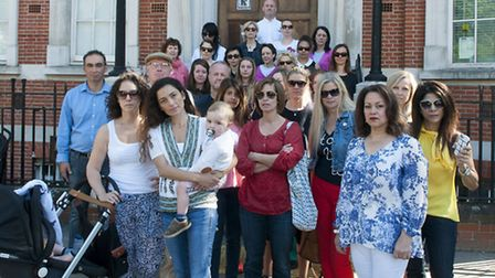 Jessica Learmond-Criqui and other Hampstead residents and families gathered outside the disused poli