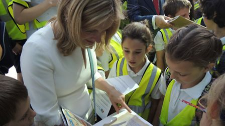 Cressida Cowell looks at dragon journals created by the pupils of St Michael's Primary School in Hig