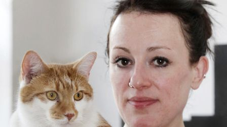 Legz, the three-legged cat, and owner Amber Knight. Picture: Anna Branthwaite