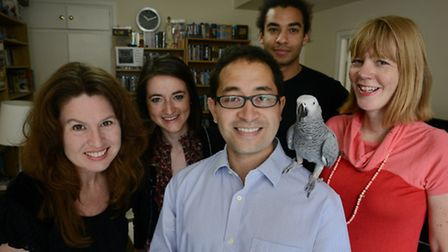 Pet parrot Coco with owner Bob (centre) and the people who helped rescue her - (from left) Hally Bow