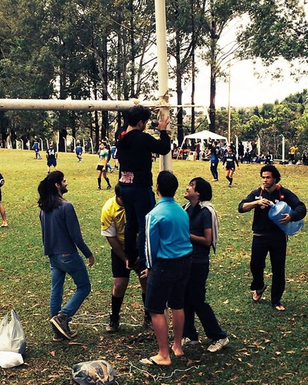A group of Brazilians convert a football goal into rugby posts
