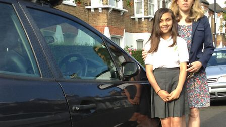 English teacher Emma Jones with youngest daughter Ria, 10, beside the damaged car door