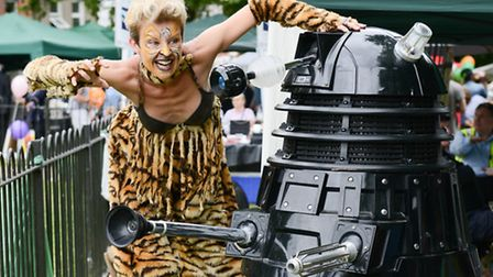 Tish Garland on stilts with a Darlek at the Jester Festival. Picture: Mark Hakansson