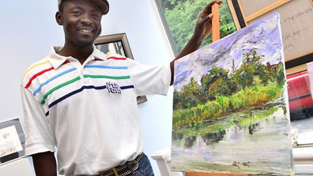 Winner of the Catto Gallery Award Edward Ofusu with his painting of Whitestone Pond. Picture: Polly