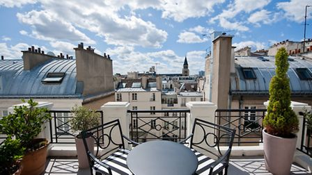 A view of St Germain's rooftops from the balcony of a room at L'Hotel.