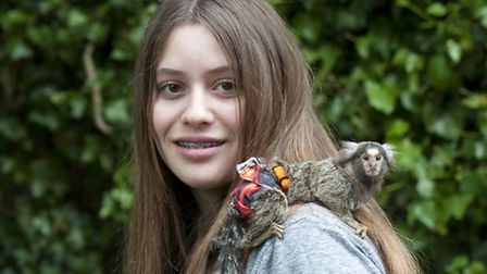 Diving master Indigo Bolandrini, 12, pictured with her pet monkey JoJo. Picture: Nigel Sutton.