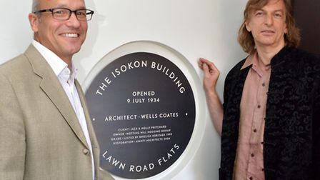 The plaque is unveiled by John Pritchard (left), grandson of Jack and Molly Pritchard and Matt Cohn,
