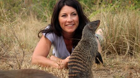 Lucy Cooke with a mongoose in Mweya Penisula, Queen Elizabeth National Park, Uganda. Credit: BBC/Bou
