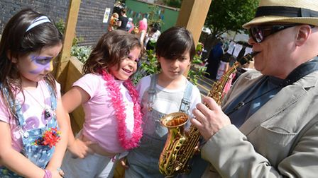 Composer John Altman at Beckford Primary School fair playing the saxaphone for pupils. Picture: Mark