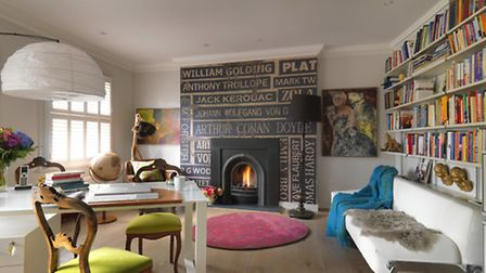 The study, with a quirky author themed fireplace