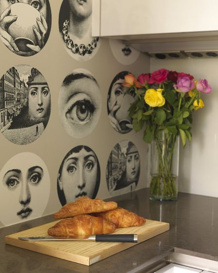 The wallpaper in the kitchen adds character to the otherwise simple style