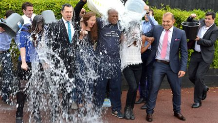 Estate agents from Paramount in West End Lane take part in an Ice Bucket Challenge for charity. Pict