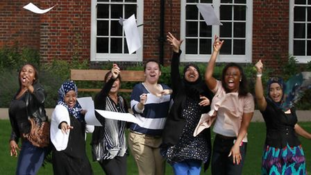 L-R: Clapton Girls Technology College students celebrate good results in their A-Levels last year.