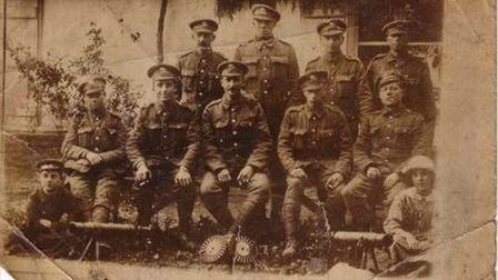Edward Connelly (seated, far left) in the only surviving photograph of the 19-year-old who fell at H