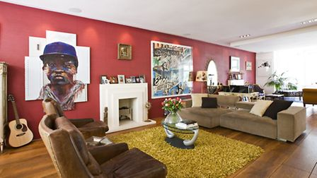 The living room showcases the owner's collection of art