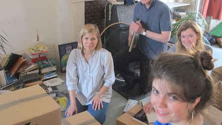 Book Aid International volunteers sort through Doris Lessing's mammoth book collection. Picture: www