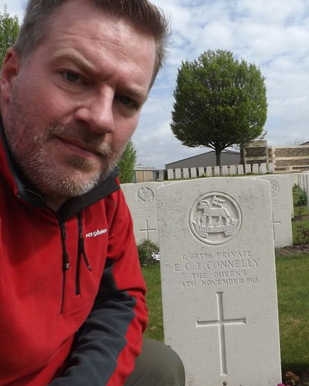 Charlie Connelly at his great-uncle's grave at the Harelbeke New British Cemetery. Picture: Charlie