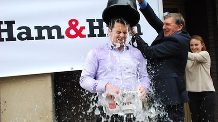 Ham&High editor Geoff Martin empties a bucket of iced water over reporter Tim Lamden. Picture: Polly